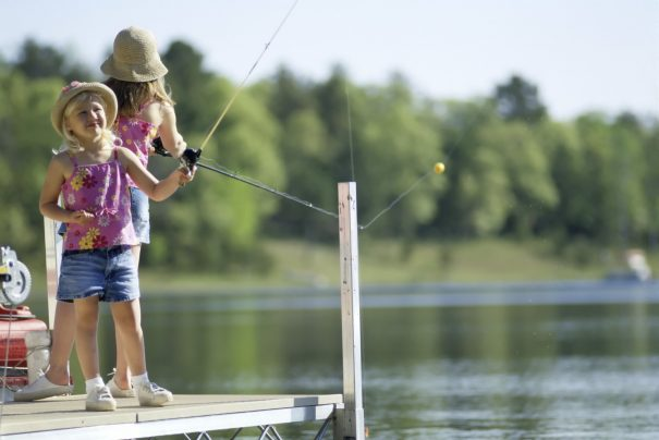 Children fishing by the lake
