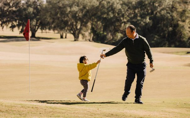 Dad golfing with son